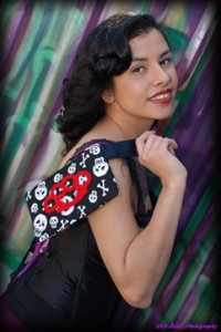 Alley DeRosas with a Poisoned Creations' Snitches Get Stiches purse.  Photo: Bobby Stewart
