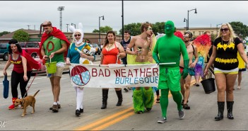 Fargo Pride Parade 2014, Left to Right: Tansy Tassels, Myst Eerious Mr. P, Enchanting Erica, Cheeky Delight, Bender !Flames!, Eric W., Charlie Valentine, Lily Vino. Front: Franklin the dog. Photo courtesy Douglas Klettke