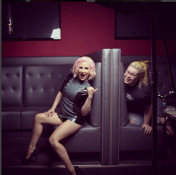 Behind the Scenes, Courtney and makeup artist Tiinia share a laugh.